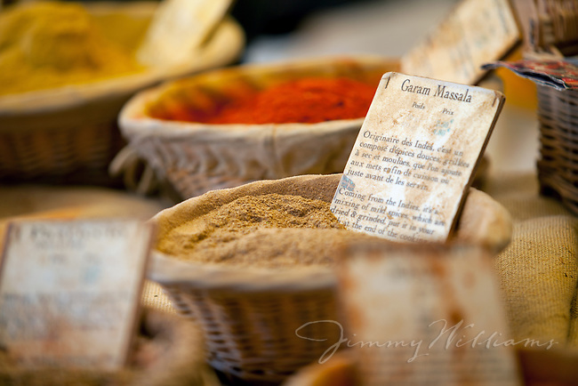 A fresh basket of Garam Masala for sale at an outdoor market in Gordes, France