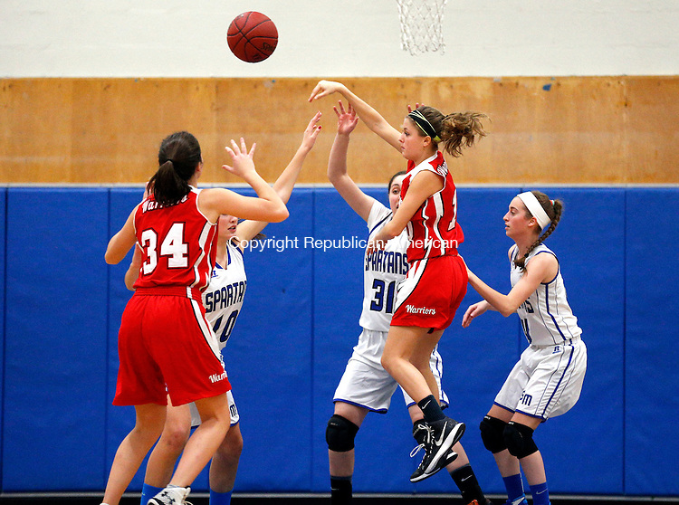 Burlington, CT- 15 December 2015-121515CM06-  Wamogo's Brooke Neller passes around a host of Lewis Mills' defenders during their Berkshire League matchup in Burlington on Tuesday.  Also in the play is teammate, Rose Kelly (34).      Christopher Massa Republican-American