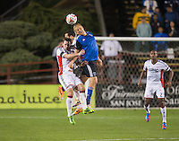 Santa Clara, California -Saturday, March 29, 2014: Steven Lenhart of SJ Earthquakes and Andy Dorman of NE Revolution jump for the ball during a match at Buck Shaw Stadium. Final Score: SJ Earthquakes 1, NE Revolution 2
