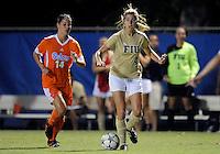 Florida International University women's soccer player Nikki Rios (4)  plays against the University of Florida on August 21, 2011 at Miami, Florida. Florida won the game 2-0. .