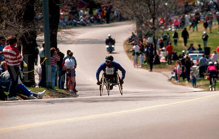 Wheelchair racer at Heartbreak Hill during Boston Marathon. Massachusetts.