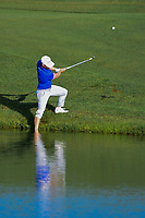 David Lingmerth (SWE) chips on to 12 with one foot in the lake during round 1 of the Shell Houston Open, Golf Club of Houston, Houston, Texas, USA. 3/30/2017.<br /> Picture: Golffile   Ken Murray<br /> <br /> <br /> All photo usage must carry mandatory copyright credit (&copy; Golffile   Ken Murray)