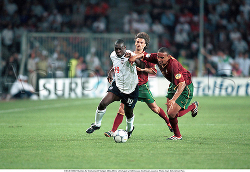 EMILE HESKEY battles for the ball with Vidigal, ENGLAND 2 v Portugal 3, EURO 2000, Eindhoven, 000612. Photo: Glyn Kirk/Action Plus...2000.European Championships.Group A.football.soccer.international.internationals.association