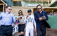 ARCADIA, CA - APRIL 07: Mike Smith is interviewed by the media on his way back to the jockeys room after winning the Santa Anita Derby at Santa Anita Park on April 07, 2018 in Arcadia, California.(Photo by Alex Evers/Eclipse Sportswire/Getty Images)