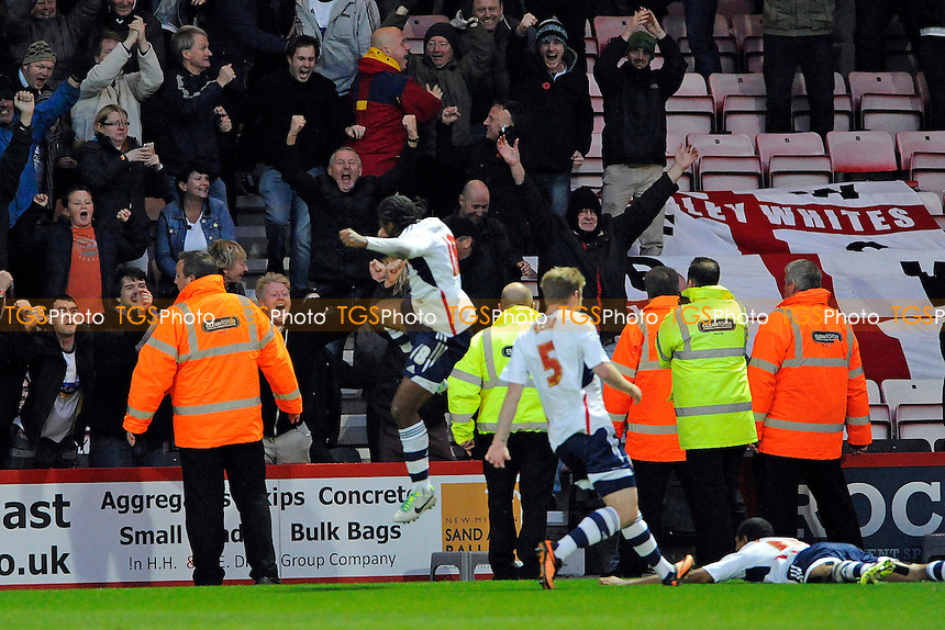 The Bolton supporters celebrate Jermaine Beckford of Bolton Wanderers (on floor)scoring the second goal- AFC Bournemouth vs Bolton Wanderers - Sky Bet Championship Football at the Goldsands Stadium, Bournemouth, Dorset - 02/11/13 - MANDATORY CREDIT: Denis Murphy/TGSPHOTO - Self billing applies where appropriate - 0845 094 6026 - contact@tgsphoto.co.uk - NO UNPAID USE