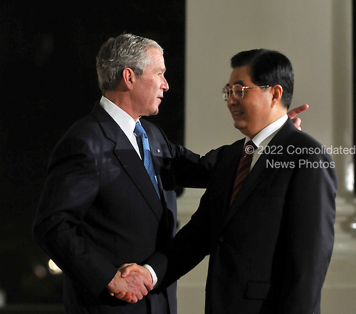 Washington, D.C. - November 14, 2008 -- United States President George W. Bush welcomes President Hu Jintao of China to the Summit on Financial Markets and the World Economy on the North Portico of the White House in Washington, D.C. on Friday, November 14, 2008..Credit: Ron Sachs / Pool via CNP