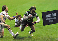 READING, ENGLAND :  Marland Yarde of London Irish dives in for a try during the Amlin Challenge Cup match between London Irish and Bordeaux-Begles at Madejski Stadium on January 18, 2013 in Reading, England.