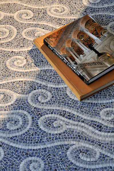 Eddies, a hand-chopped stone mosaic shown in Blue Bahia, Bardiglio, and Carrara, is part of the Silk Road® collection by New Ravenna.