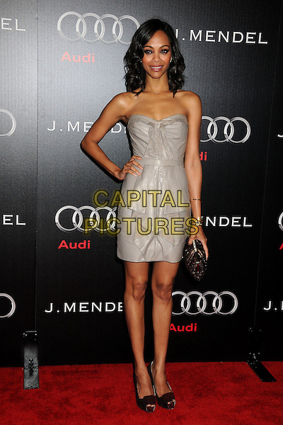 ZOE SALDANA .Audi and J. Mendel Celebrate the 2011 Golden Globe Awards held at Cecconi's, Los Angeles, California, USA, .9th January 201..full length strapless silver dress gold beige metallic shiny ruffle  grey gray platform maroon red brown  suede peep toe shoes burgundy bronze clutch bag hand on hip .CAP/ADM/BP.©Byron Purvis/AdMedia/Capital Pictures.