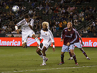 LA Galaxy defender Sean Franklin (28) leaps past teammate defender Abel Xavier (17) to head a ball out of the box as Colorado Rapids forward Conor Casey (9) looks on late in the second half. The Colorado Rapids defeated the LA Galaxy 1-0 during the preliminary rounds of the 2008 US Open Cup at Home Depot Center stadium in Carson, Calif., on Tuesday, May 27, 2008.