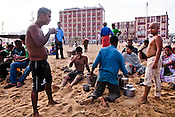Tourists have a cup of tea after a dip in the sea on Puri Beach along the Bay of Bengal in Puri, Orissa, India. A dip in its salty waters is believed to hold great religious significance, as a result these golden sand beaches sees is a never-ending rush of pilgrims and tourists. Photo: Sanjit Das/Panos
