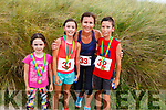 Clare, Leah, Ailish and Evan O'Grady from Shannon Co Clare just over the finish line at the Banna 5 and 10k race on Sunday morning.