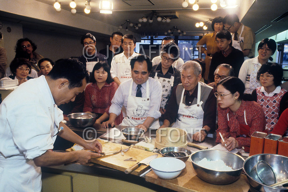 October, 1980. Tokyo, Japan. A chef demonstrates a traditional Japanese cuisine lesson in the Ginza district of Tokyo.