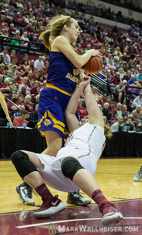 Western Illinois forward Olivia Braun steals a rebound away from Florida State center Chatrice White during the second half of a first-round game of the NCAA women's college basketball tournament in Tallahassee, Fla., Friday, March 17, 2017. Florida State defeated Westeren Illinois 87-66. (AP Photo/Mark Wallheiser)
