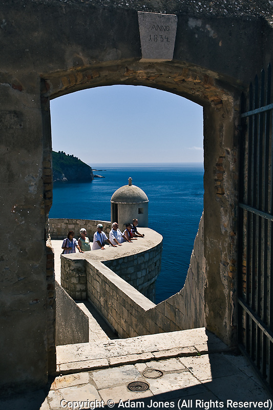 Adriatic Sea framed by gate on city wall around Old Town Dubrovnik, UNESCO World Heritage Site