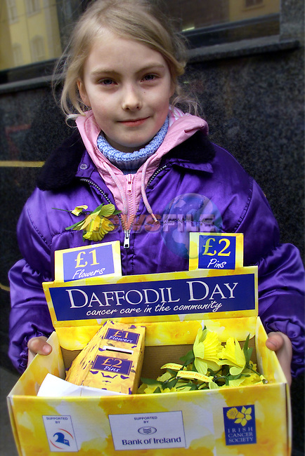 Amber-Kate Allen pictured selling some daffodils for cancer care in the community..pic:Arthur Carron/ Newsfile