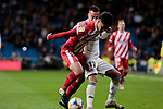 Real Madrid's Lucas Vazquez and Girona FC's Paik Seung-ho during Copa del Rey match between Real Madrid and Girona FC at Santiago Bernabeu Stadium in Madrid, Spain. January 24, 2019. (ALTERPHOTOS/A. Perez Meca)