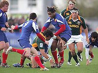 South African centre Francois Hougaard loses possession as he is tackled by French centre Mathieu Bastareaud during the Division A U19 World Championship clash at Ravenhill.