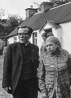 Mary McElhone, mother of 23 year old Peter McElhone, with Father McGirr, local Roman Catholic curate, after the death of her son in a shooting incident involving British soldiers near Pomeroy, Co Tyrone, N Ireland, 8th August 1974. A soldier was charged with murder the following day. 197408080428D<br />