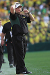 Oregon head coach Chip Kelly looks at replay on a big screen during the 96th Rose Bowl in Pasadena, Ca January 1, 2010.