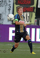 CHESTER, PA - AUGUST 12, 2012:  Brian Carroll (7) of the Philadelphia Union clears the ball up field against the Chicago Fire during an MLS match at PPL Park, in Chester, PA on August 12. Fire won 3-1.
