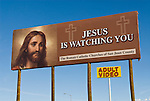 Billboard by adult video store: Jesus is Watching You