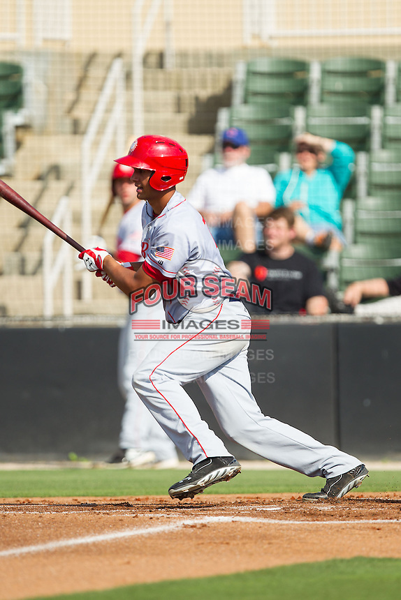 Drew Ward (11) of the Hagerstown Suns follows through on his swing against the Kannapolis Intimidators at CMC-Northeast Stadium on May 31, 2014 in Kannapolis, North Carolina.  The Intimidators defeated the Suns 3-2 in game one of a double-header.  (Brian Westerholt/Four Seam Images)