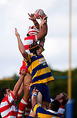 R. Lava manages to tap lineout ball back despite the efforts of A. Van Der Heijden. Counties Manukau Premier Club Rugby, Patumahoe vs Karaka played at Patumahoe on Saturday 22nd April 2006. Karaka won 19 - 6.