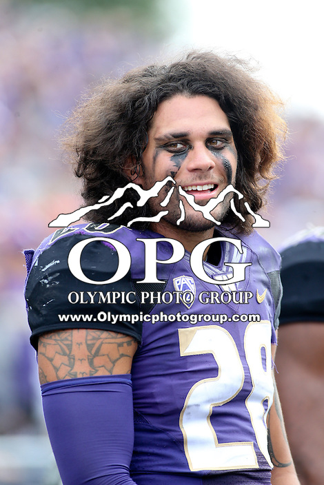03 September 2016:  Washington's #28 Psalm Wooching was all smiles on the sidelines during the game against Rutgers.  Washington defeated Rutgers 48-13 at the University of Washington in Seattle, WA.