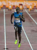 Usain BOLT of Jamaica (Men's 100m) on his way to winning his heat in under 10 seconds during the Sainsburys Anniversary Games Athletics Event at the Olympic Park, London, England on 24 July 2015. Photo by Andy Rowland.