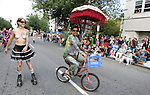 Brightly painted nude bicycle rider and a skater delights the crowd during the 21st  Annual Fremont Summer Solstice Parade in Seattle on June 21, 2009.  The parade was held Saturday, bringing out painted and naked bicyclists, bands, belly dancers and floats. (Jim Bryant Photo © 2009)