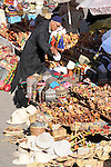 A man looks at hats in the Souk in Marrakesh, Morocco.