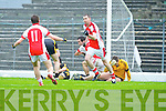 Rathmore's Paul Reen peels away to celebrate his last minute goal with George O'Keeffe to win their clash against Crokes on Saturday leaving Crokes keeper Alan Kelly dejected on the ground