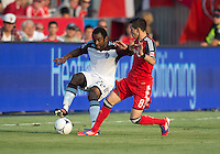 18 July 2012: Colorado Rapids defender Marvell Wynne #22 and Toronto FC midfielder Eric Avila #8 in action during an MLS game between the Colorado Rapids and Toronto FC at BMO Field in Toronto, Ontario..Toronto FC won 2-1..