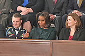 "First lady Michelle Obama flashes a ""thumbs-up"" in response to a passage in United States President Barack Obama's State of the Union Address to a Joint Session of Congress in the U.S. Capitol on Tuesday, January 28, 2014.  From left to right: U.S. Army Sergeant 1st Class Cory Remsburg, first lady Michelle Obama, and Misty DeMars. <br /> Credit: Ron Sachs / CNP<br /> (RESTRICTION: NO New York or New Jersey Newspapers or newspapers within a 75 mile radius of New York City)"