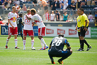New York Red Bulls Markus Holgersson (5), Joel Lindpere (20), and Juan Agudelo (17) celebrate at the final whistle. The New York Red Bulls defeated the Philadelphia Union  3-2 during a Major League Soccer (MLS) match at PPL Park in Chester, PA, on May 13, 2012.