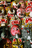 Mexico City. Brightly coloured souvenir masks at the street market near Templo Mayor, Zocalo. Plaza de la Constituicao.