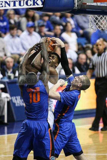 Kentucky center Dakari Johnson struggles against Florida's defense during the first half of the Kentucky vs. Florida game at Rupp Arena in Lexington, Ky.,on Saturday, March 7, 2015. UK defeated Florida 67-50, completing a perfect regular season. Photo by Adam Pennavaria | Staff
