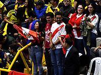 BOGOTÁ-COLOMBIA, 08-01-2020: Hinchas de Perú, animan a su equipo antes de partido entre Perú y Colombia en el Preolímpico Suramericano de Voleibol, clasificatorio a los Juegos Olímpicos Tokio 2020, jugado en el Coliseo del Salitre en la ciudad de Bogotá del 7 al 9 de enero de 2020. / Fans from Peru, cheer for their team prior a match between Peru and Colombia, in the South American Volleyball Pre-Olympic Championship, qualifier for the Tokyo 2020 Olympic Games, played in the Colosseum El Salitre in Bogota city, from January 7 to 9, 2020. Photo: VizzorImage / Luis Ramírez / Staff.