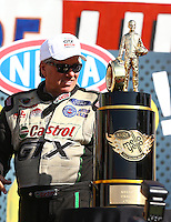 Nov 10, 2013; Pomona, CA, USA; NHRA funny car driver John Force walks up to his championship trophy during the Auto Club Finals at Auto Club Raceway at Pomona. Mandatory Credit: Mark J. Rebilas-