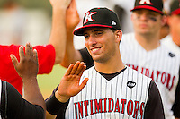 Rangel Ravelo #22 of the Kannapolis Intimidators high fives teammates following their win over the Delmarva Shorebirds at Fieldcrest Cannon Stadium on August 7, 2011 in Kannapolis, North Carolina.  The Intimidators defeated the Shorebirds 8-3.   (Brian Westerholt / Four Seam Images)