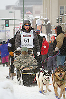 Michael Williams Jr. leaves the 2011 Iditarod ceremonial start line in downtown Anchorage, during the 2012 Iditarod..Jim R. Kohl/Iditarodphotos.com
