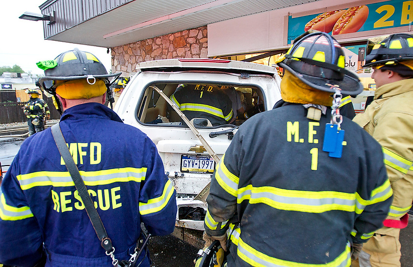 Multi-car crash at about 6:15 pm on rain-slicked Rt. 71 ends with a Chevy Suburban careening through the front wall and windows of the 7-11 convenience store. The driver of the SUV was extricated by Manasquan firefighters and transported to the hospital.   6/7/13  photo by Andrew Mills