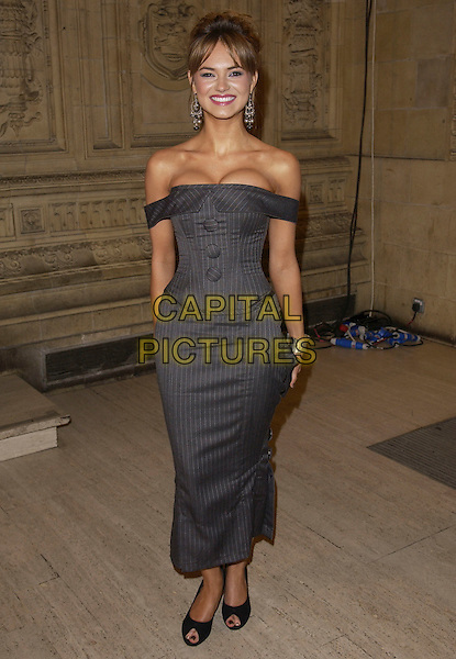 KARA TOINTON.National Television Awards 2005 at the Royal Albert Hall.London, United Kingdom.Ref: FIN.full length grey pinstriped fitted off the shoulder dress copycat Keira Knightley small tiny waist hourglass.www.capitalpictures.com.sales@capitalpictures.com.© Capital Pictures .