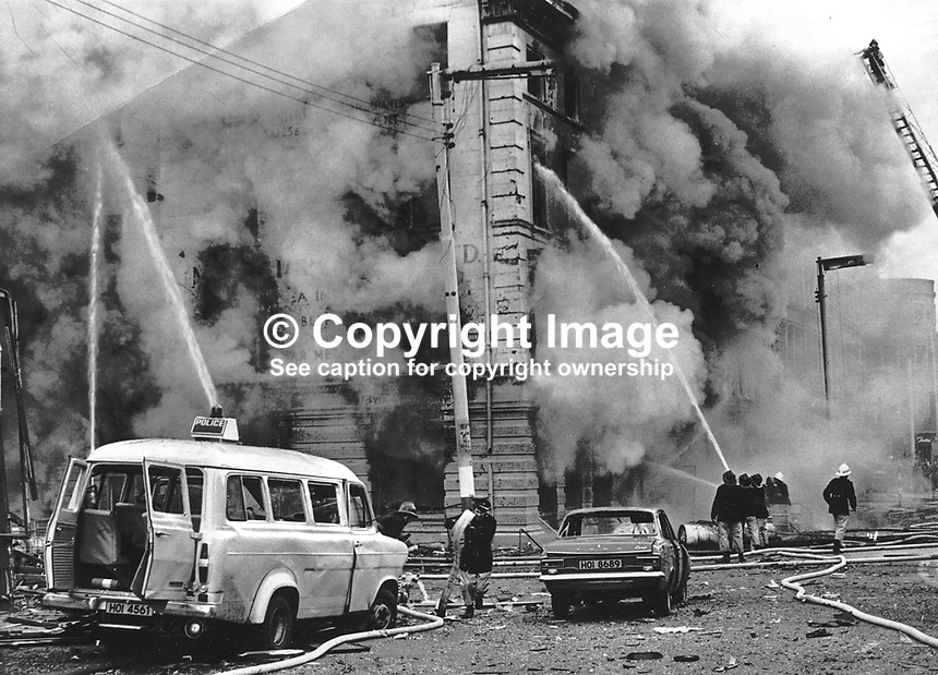 Firemen tackle blaze following Provisional IRA 500 lb bomb attack on the RUC police station, Musgrave Street, Belfast, N Ireland. Adjacent buildings seemed to have suffered more damage than the actual police station. It was claimed the bomb attack was in retaliation for the death of IRA member Hugh Coney who was shot dead by a sentry during an escape attempt at the Maze Prison. Twenty nine other prisoners were captured within a few yards of the prison, and the remaining three were back in custody within 24 hours. 1974110604d.<br />