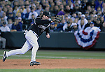 06 October  2007:  Colorado's Todd Helton makes a play at first during the Rockies 2-1 victory over the Philadelphia Phillies to win their National League Division Series at Coors Field, Denver, Colorado.
