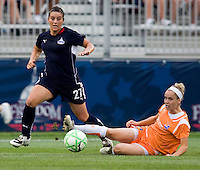 Washington Freedom defender (27) Ali Krieger has the ball tackled away from her by Sky Blue FC midfielder (7) Kelly Parker at the Maryland SoccerPlex in Boyds, Maryland.  The Washington Freedom defeated Sky Blue FC, 3-1, to secure a place in the playoffs.