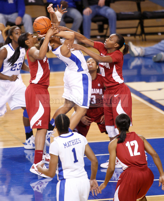 UK guard Bernisha Pinket is double teamed by Alabama's Kyra Crosby and Meghan Perkins during the first half of the UK Women's basketball game against Alabama on 1/29/12 at Memorial Coliseum in Lexington, Ky. Photo by Quianna Lige | Staff