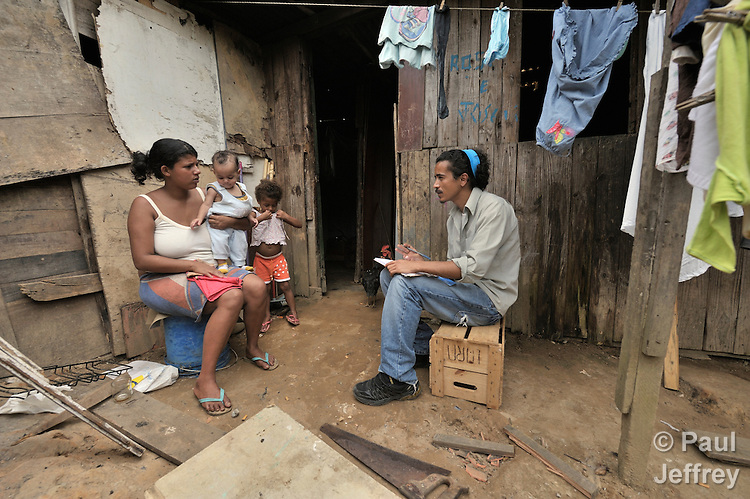 Leonardo Duarte (right), a staff member of the Street Children Project in San Bernando do Campo, Brazil, visits Casia Rosemarie in her home. The 17-year old is mother of twins.