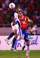 SAN JOSE, COSTA RICA - September 06, 2013: Matt Besler (5) of the USA MNT heads the ball away from Bryan Ruiz (10) of the Costa Rica MNT during a 2014 World Cup qualifying match at the National Stadium in San Jose on September 6. USA lost 3-1.